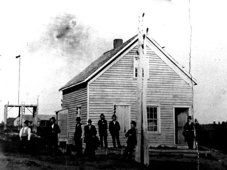 Signal Service weather office in South Dakota (c. 1890). The instrument shelter is attached to the building with the wind equipment located to the rear of the building