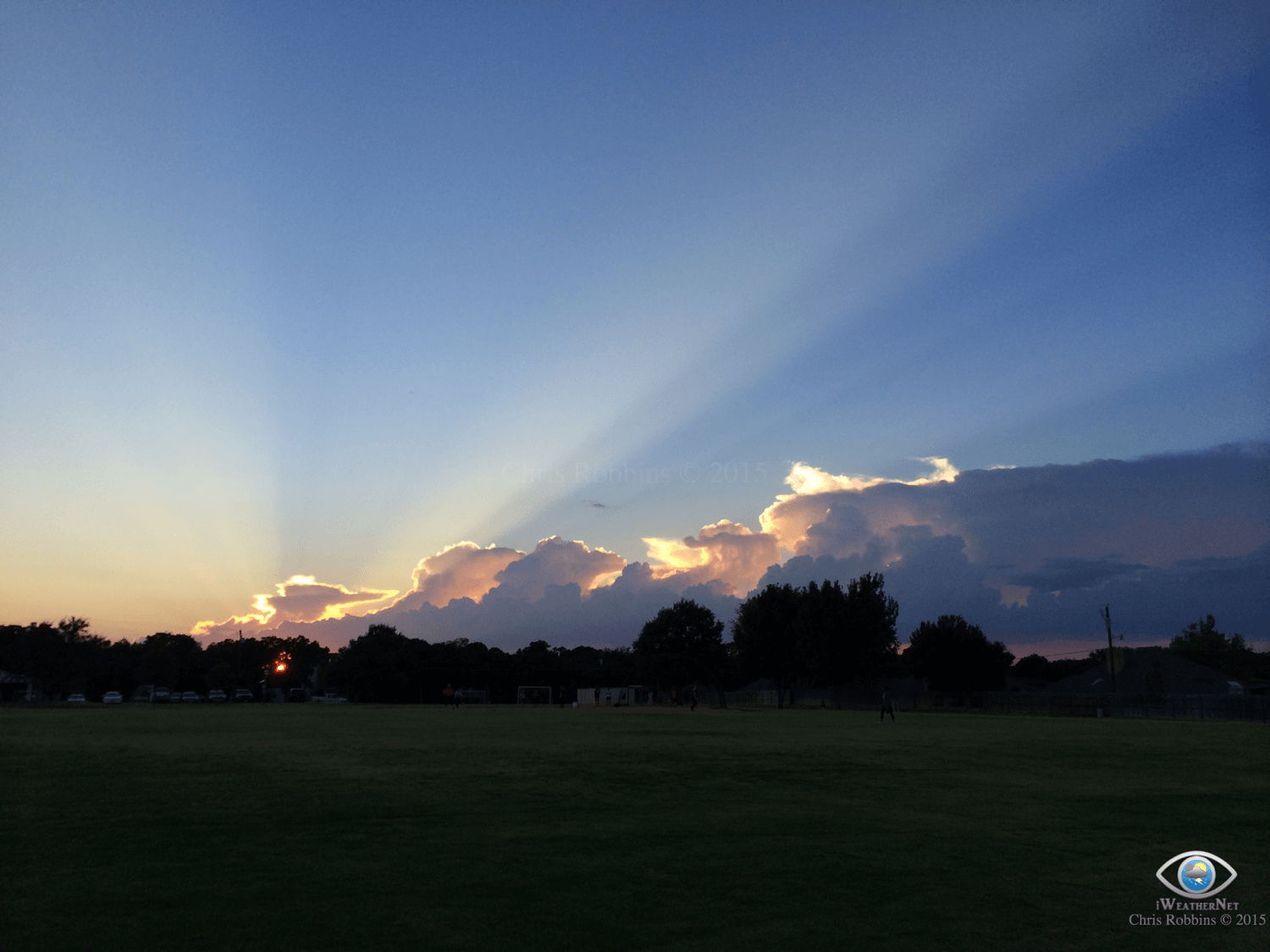 Crepuscular rays (sunset) created by towering cumulus over 100 miles to the west).